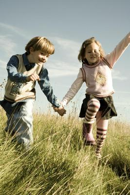 Children running across Meadow