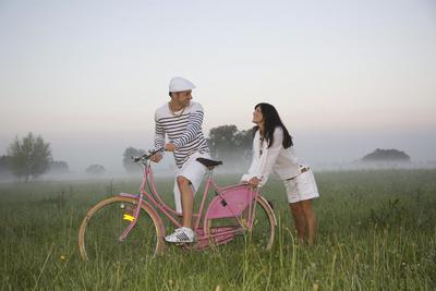Couple with pink Bike