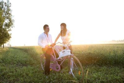 Young Couple with Bike Outside
