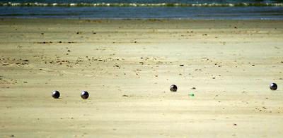 Boules, bocce, pétanque, ball game on the beach